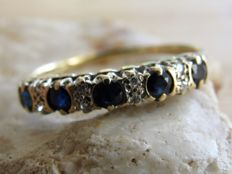 Gold eternity ring with 5 x natural sapphire and 8 x diamond.