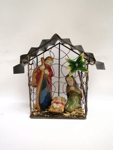 Nativity scene, complete - ornamental wrought ironwork with pottery group.