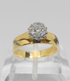 18 kt yellow gold cocktail ring and 13 diamonds totalling 0.45 ct.