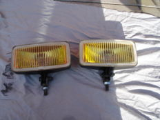 Two FOG LIGHTS type HELLA 173 with a width of 173 mm from the 1980s and 1990s.