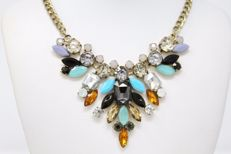 Joan Rivers statement large leaves necklace