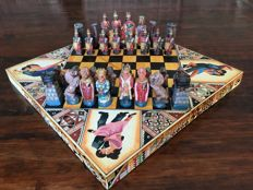 Stone chess set from Argentina in foldable decorative storage chest