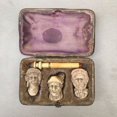 Meerschaum pipe set in case depicting one man and 2 women - Germany, ca. 1870
