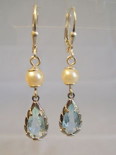 Earrings with light blue spinels and white salt water pearls