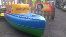 Boat coming from a fairground merry-go-round