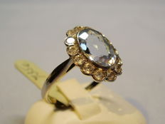 Ring with light blue spinel and corundum entourage