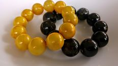 Set of 2 Baltic Amber round modified beads bracelets egg yolk and black colours, 113 grams