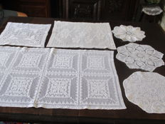 Lot of six table cloths crocheted with white shiny mercerise yarn.