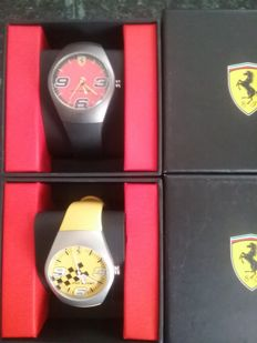 Exceptional lot of 2 Ferrari Pit Stop watches: red and yellow