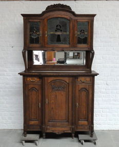 Oak cabinet with facet cut mirror and three stained glass doors - Belgium - ca. 1900