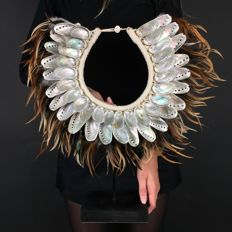 Eye-catching shell necklace on stand - Papua New Guinea - 21st century