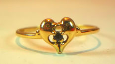 Ring with two dolphins in 18 kt yellow gold, 1 g. - 1 blue sapphire 0.05 ct = USA 6 3/4 & 54 FR.