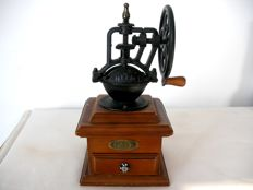 Cast iron coffee grinder.