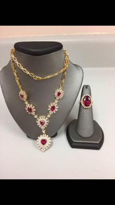 14 kt gold necklace + ring with rubies and sapphires