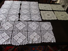 Lot of three white crochet table runners + four yellow doilies.