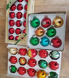 Forty one vintage made glass Christmas ornaments with boxes