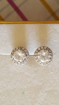Pair of white gold vintage style earrings with white central sapphire and accent sapphires.