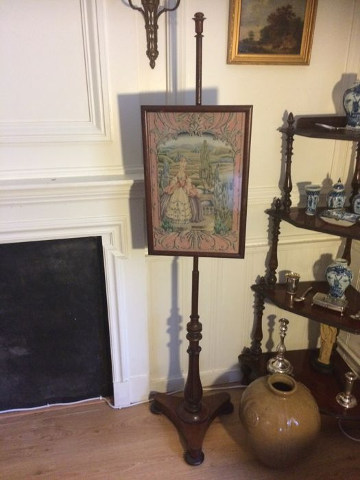 A William IV pole screen on a rosewood base - circa 1830