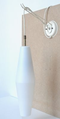 Designer and manufacturer unknown - a white uberfang/opaline glass wall light with brass and metal mount/fixation
