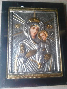 A silver-plated icon depicting a Byzantine Madonna