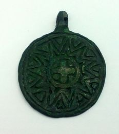 Early medieval pendant, the Viking period, decorated with sun and cross in the center. 33x26mm