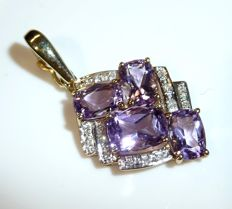 Clip pendant in 14kt gold with approx. 5ct. Amethyst + 15 diamonds of 0.15ct. Mint condition