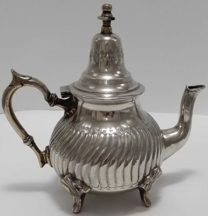 A silver plated teapot with floral engraved decor -Moroccan, AHMED EL-HOUAR FES, ca, 1920