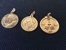 Three gold charms