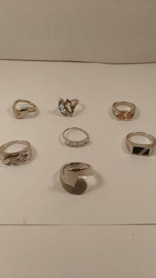 Lot of 7 925% silver rings with natural gemstone. No reserve price.