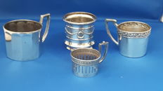 Three silver glass holders and silver cup, Germany