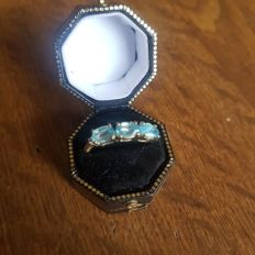 Ladies 9 Ct Gold Blue Oval Cut Topaz Trilogy Dress Ring with Diamond to Shoulders