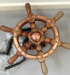 Old wooden steering wheel and suspension with chain