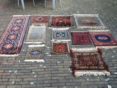 11 Persian hand-knotted rugs