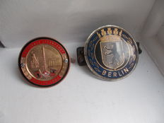2 x VINTAGE  BERLIN CAR BADGES  brass and enamel NATIONAL STENFAHRT M.S.C. VICTORIA BERLIN 1960  good condition .  The other plastic and alloy back old 1940s 50s in poor condition