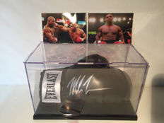 Boxing glove hand-signed with silver pen by Mike Tyson in a display case + Coa