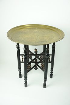 Old oriental ebonised wooden table frame with yellow copper table top - first half of 20th century.