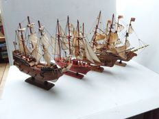 Wooden sailing boats.