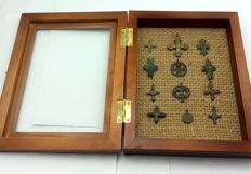 Early medieval bronze crosses, IX-XII century, in the frame for the exposure (12) 19x18 mm - 38x30mm