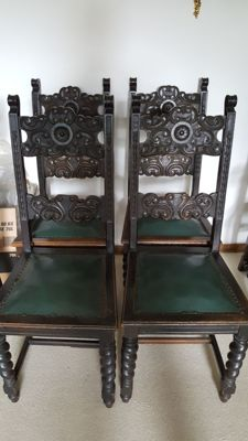 5 black baroque chairs from the 19th century