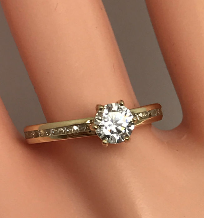Special gold solitaire/memory ring with zirconia, inner size 16.2 mm