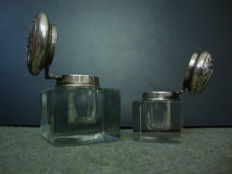 Two art noveau glass with silver lids inkwells