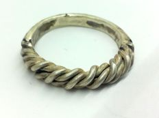 Early medieval silver ring of Vikings, woven of several threads, and forged into a rod, 20 mm. 5.2gr