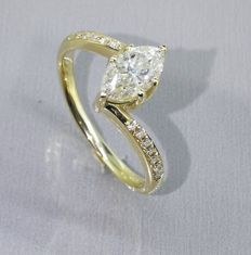 Yellow gold diamond ring marquise cut diamond of 0.65 ct & 14 diamonds of 0.15 ct in total