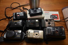Twelve 35 mm compact cameras of various brands such as Pentax, Canon, Nikon and Chinon
