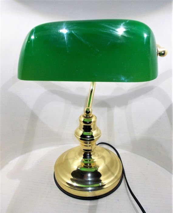 A beautiful banker's lamp in brass with green glass