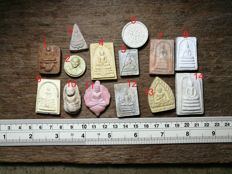 A collection of 14 Buddhist amulets - Thailand - early 21st century