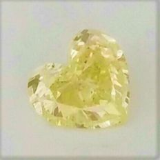 Heart Cut  - 1.35 carat  - Natural Fancy Vivid Yellow - Si2 clarity  - Natural Diamond  Comes With AIG Certificate + Laser Inscription