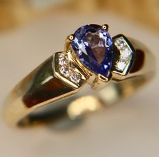 Vintage 9Kt. gold ring in excellent state with clear blue Tanzanite in a pear shape enchanted by 6 H/VS clear Diamonds for total of 0.72ct in gems