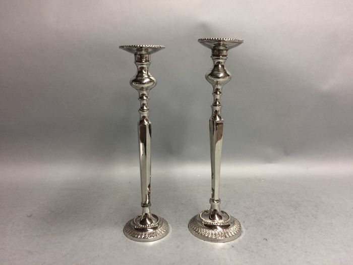 Two high silver plated single lights candle stands, England, ca. 1940