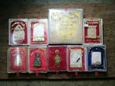 A collection of 9 Buddhist amulets - Thailand - 21st century